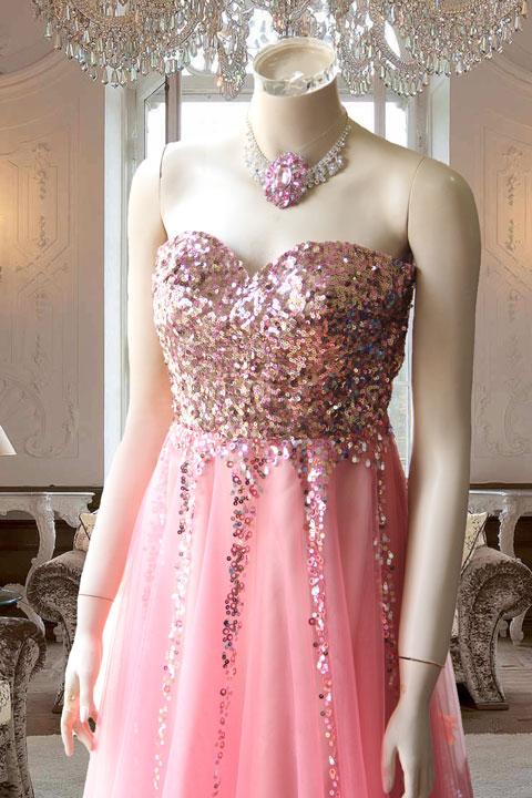 サーモンピンクのスパンコール素材のAラインステージドレス